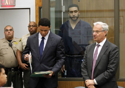 Former NFL football player Kellen Winslow Jr., second from right, stands behind lawyers Brian Watkins, third from right, and Harvey Steinberg, right, during his arraignment Friday, June 15, 2018, in Vista, Calif. The former tight end was arrested Thursday on charges of rape and other sex crimes, the day he was to appear in court on an unrelated burglary charge. (Hayne Palmour/San Diego Union-Tribune via AP, Pool)