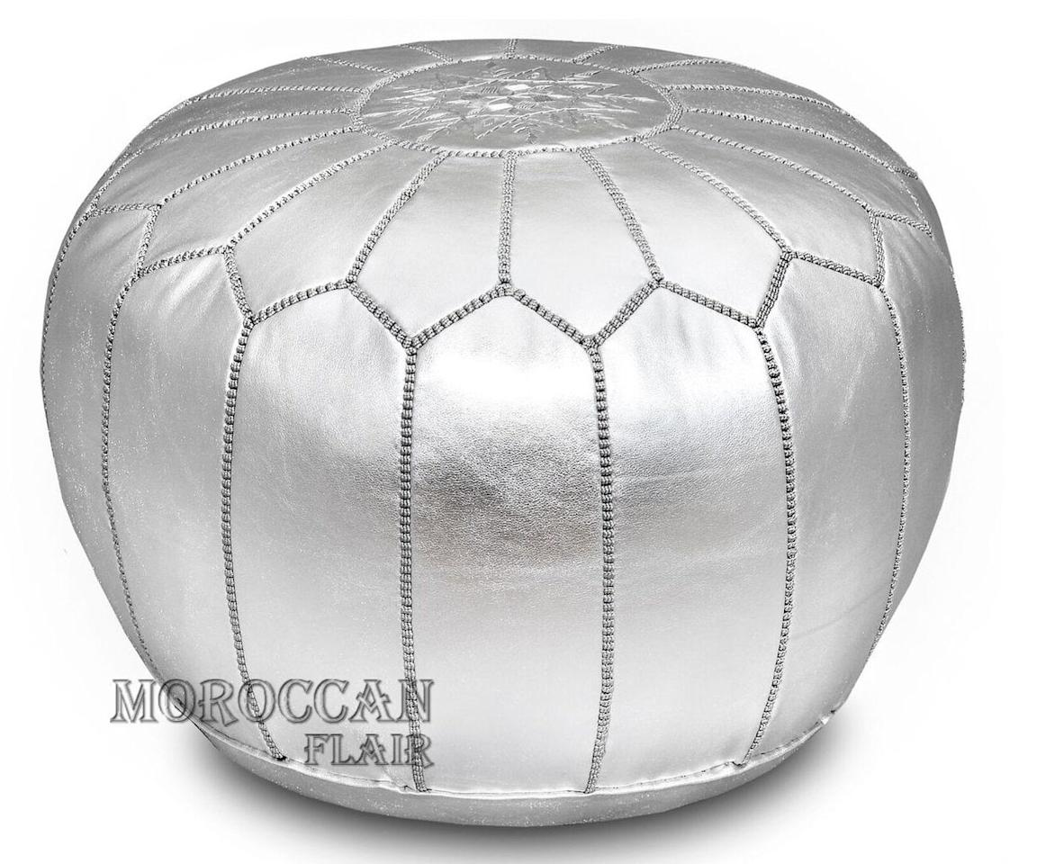 "<p><a href=""https://www.popsugar.com/buy/Moroccan-Flair-Leather-Moroccan-Pouf-Silver-505081?p_name=Moroccan%20Flair%20Leather%20Moroccan%20Pouf%20in%20Silver&retailer=amazon.com&pid=505081&price=180&evar1=casa%3Aus&evar9=46784503&evar98=https%3A%2F%2Fwww.popsugar.com%2Fphoto-gallery%2F46784503%2Fimage%2F46791575%2FMoroccan-Flair-Metallic-Leather-Moroccan-Pouf-in-Silver&list1=shopping%2Camazon%2Cdecor%20shopping%2Chome%20shopping&prop13=api&pdata=1"" rel=""nofollow"" data-shoppable-link=""1"" target=""_blank"" class=""ga-track"" data-ga-category=""Related"" data-ga-label=""https://www.amazon.com/gp/product/B01MZDN6NP/ref=ppx_yo_dt_b_asin_title_o00_s00?ie=UTF8&amp;th=1"" data-ga-action=""In-Line Links"">Moroccan Flair Leather Moroccan Pouf in Silver</a> ($180)</p>"
