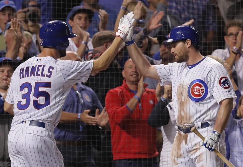 Chicago Cubs' Cole Hamels, left, celebrates his home run against the Pittsburgh Pirates wit teammate Daniel Murphy during the third inning of a baseball game Monday, Sept. 24, 2018, in Chicago. (AP Photo/Jim Young)