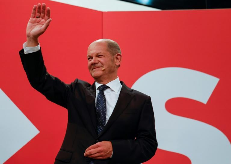 Olaf Scholz will scramble for coalition partners after his SPD party beat the conservatives (AFP/Odd ANDERSEN)