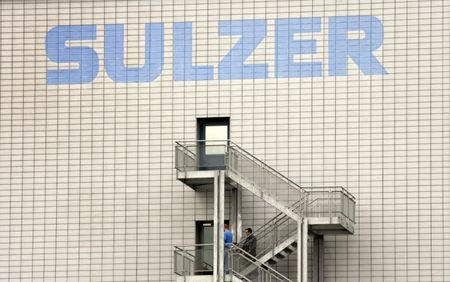 People stand on stairs at a building of Swiss engineering group Sulzer AG in the town of Winterthur north of Zurich