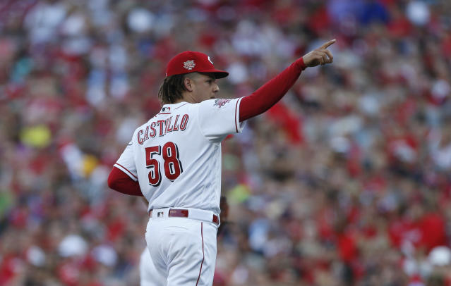 Cincinnati Reds starting pitcher Luis Castillo (58) points to the stands as he leaves the field during the first inning of a baseball game against the St. Louis Cardinals, Saturday, July 20, 2019, in Cincinnati. (AP Photo/Gary Landers)