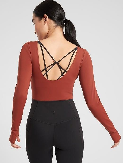 <p>There's plenty of coverage in the front of this stylish <span>Athleta Align Open Back Bodysuit</span> ($79) . . . even if you're just working out solo at home. </p>