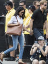 <p>Meghan Markle made her first public appearance with Prince Harry at a tennis match during the Invictus Games. The actress proved she wasn't quite ready for royal life as she donned a white shirt (strangely called 'The Husband'), ripped jeans and tan leather flats.<br>[Photo: Getty] </p>