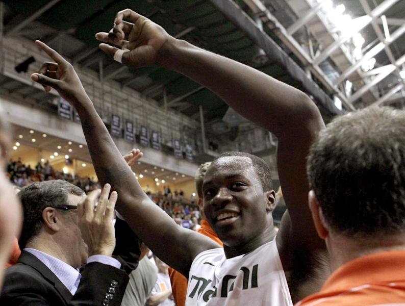 FILE - In this Jan. 23, 2013, file photo, Miami's Durand Scott celebrates their 90-63 win over Duke in an NCAA college basketball game in Coral Gables, Fla. In a season of parity that has produced quite a few surprises, a few of the unexpected turns, such as Miami's success, have stood out. (AP Photo/Alan Diaz, File)