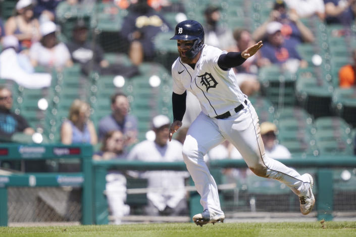 Detroit Tigers' Eric Haase heads home to score during the third inning of a baseball game against the New York Yankees, Sunday, May 30, 2021, in Detroit. (AP Photo/Carlos Osorio)