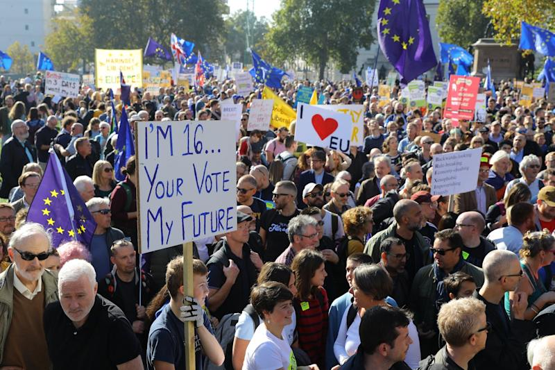 Demonstrators with banners during the People's Vote march last year (EPA)