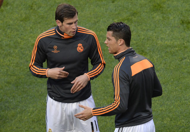 Real's Gareth Bale, left, and Real's Cristiano Ronaldo chat prior to the Champions League final soccer match between Atletico Madrid and Real Madrid in Lisbon, Portugal, Saturday, May 24, 2014. (AP Photo/Paulo Duarte)
