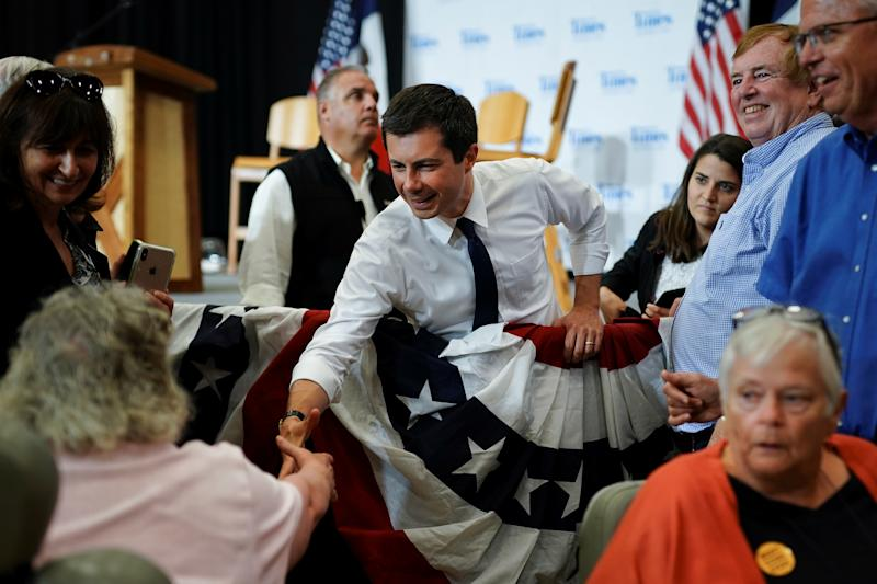 Pete Buttigieg, South Bend Mayor and Democratic presidential hopeful, shakes hands with an attendee in a wheelchair following a campaign event at Saint Ambrose University in Davenport, Iowa, U.S. September 24, 2019. REUTERS/Elijah Nouvelage