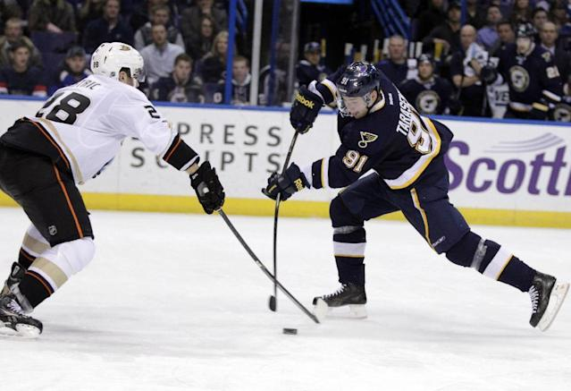 St. Louis Blues' Vladimir Tarasenko (91) fires a shot past Anaheim Ducks' Mark Fistric (28) in the second period of an NHL hockey game, Saturday, Dec. 7, 2013, in St. Louis. (AP Photo/Tom Gannam)