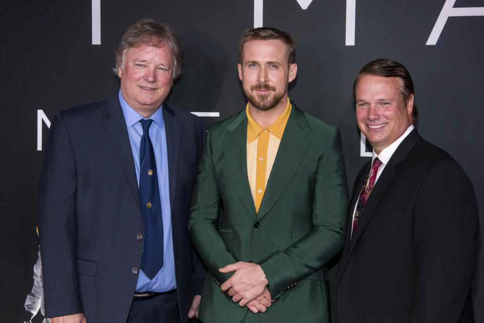 "FILE – In this Oct. 4, 2018 file photo, Rick Armstrong, left, Ryan Gosling and Mark Armstrong attend the ""First Man"" premiere at the National Air and Space Museum of the Smithsonian Institution in Washington. (Photo by Charles Sykes/Invision/AP, File)"