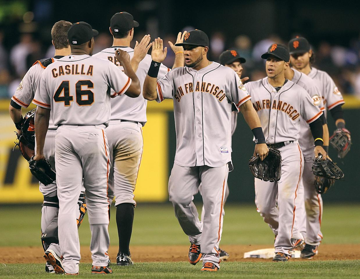 SEATTLE, WA - JUNE 15:  Members of the San Francisco Giants celebrate after defeating the Seattle Mariners 4-2 at Safeco Field on June 15, 2012 in Seattle, Washington.(Photo by Otto Greule Jr/Getty Images)