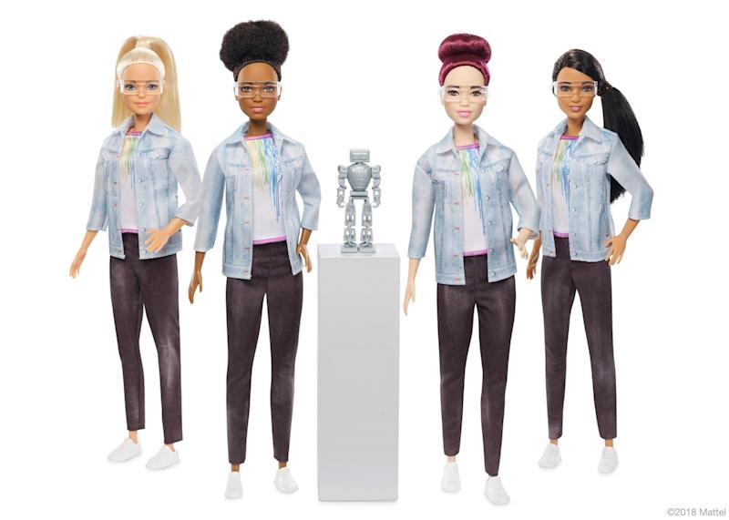 A number of Barbie dolls are dressed as robotics engineers.