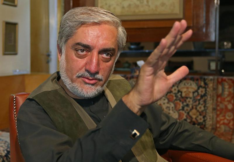 Afghan presidential candidate Abdullah Abdullah speaks during an interview with The Associated Press at his residence in Kabul, Afghanistan, Saturday, Aug. 9, 2014. He talked about the audit of the recent disputed presidential election and agreement to resolve the dispute. (AP Photo/Rahmat Gul)