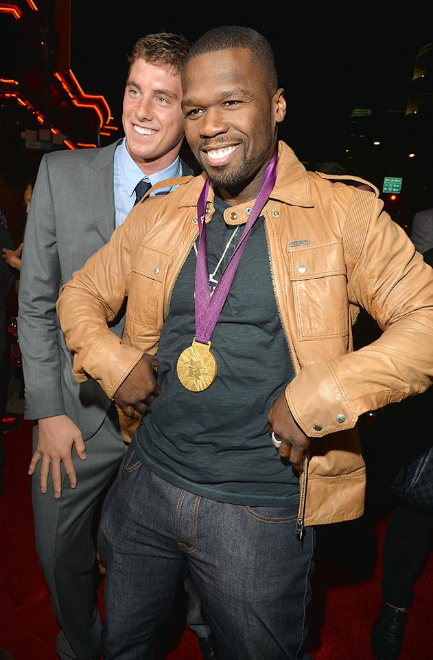 "50 Cent looked proud to pose with an Olympic gold medal on Monday. The rapper borrowed the medal from Olympic swimmer Tyler Clary, who landed it after he placed first in the 200-meter backstroke. The guys met up on the red carpet at the Los Angeles premiere of ""End of Watch."" (9/17/2012)"