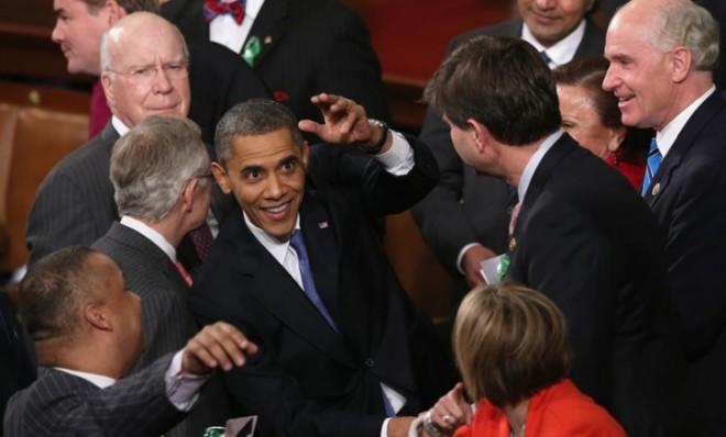 President Obama greets members of Congress after his State of the Union address on Feb. 12.