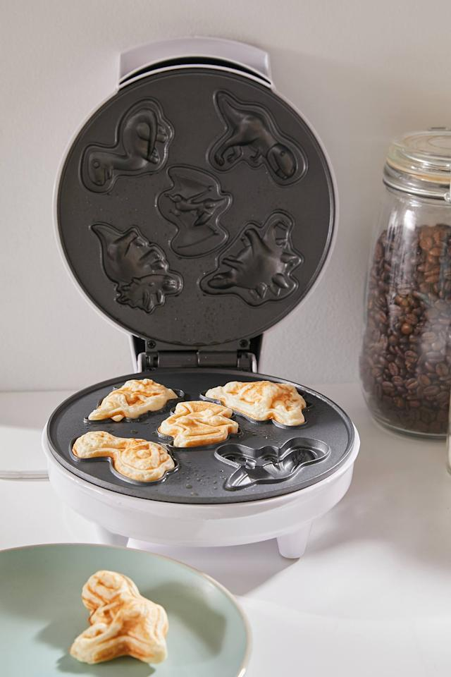 """<p>We all know someone who needs this <a href=""""https://www.popsugar.com/buy/Dinosaur-Waffle-Maker-543285?p_name=Dinosaur%20Waffle%20Maker&retailer=urbanoutfitters.com&pid=543285&price=35&evar1=casa%3Aus&evar9=45677589&evar98=https%3A%2F%2Fwww.popsugar.com%2Fhome%2Fphoto-gallery%2F45677589%2Fimage%2F47177164%2FDinosaur-Waffle-Maker&list1=shopping%2Curban%20outfitters%2Chome%20decor%2Cfurniture%2Csmall%20space%20living%2Chome%20shopping&prop13=api&pdata=1"""" rel=""""nofollow"""" data-shoppable-link=""""1"""" target=""""_blank"""" class=""""ga-track"""" data-ga-category=""""Related"""" data-ga-label=""""https://www.urbanoutfitters.com/shop/dinosaur-waffle-maker?category=small-appliances&amp;color=001&amp;type=REGULAR"""" data-ga-action=""""In-Line Links"""">Dinosaur Waffle Maker</a> ($35).</p>"""