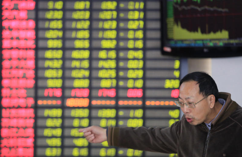 An investor looks gestures at a private securities company in Shanghai, China, Wednesday, Dec. 11, 2013. Asian stocks were mostly down Wednesday as investors factored in the prospect of the Federal Reserve reducing its lavish monetary stimulus this month. (AP Photo)