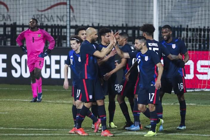 US players celebrate their fourth goal during the international friendly soccer match between USA and Jamaica