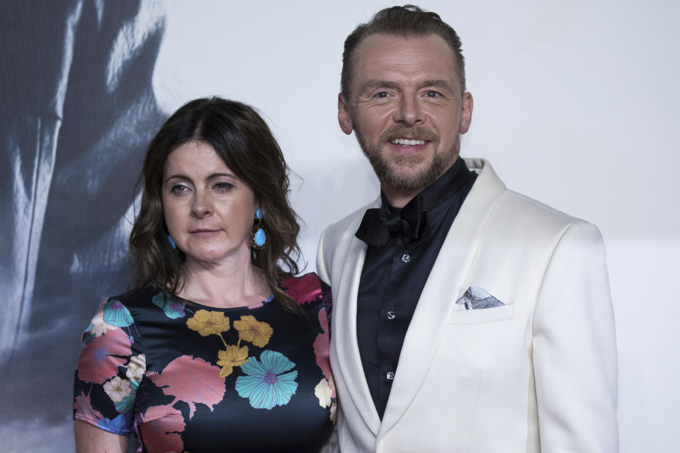 Actor Simon Pegg, right, and his wife Maureen Pegg pose for photographers upon arrival at the premiere of the film 'Mission Impossible Fallout', in London, Friday, July 13, 2018. (Photo by Vianney Le Caer/Invision/AP)