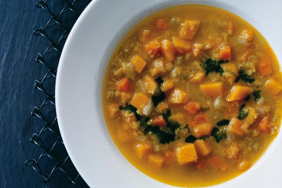 """This spicy and satisfying soup becomes a full meal when served over rice. <a href=""""https://www.epicurious.com/recipes/food/views/curried-squash-and-red-lentil-soup-351416?mbid=synd_yahoo_rss"""" rel=""""nofollow noopener"""" target=""""_blank"""" data-ylk=""""slk:See recipe."""" class=""""link rapid-noclick-resp"""">See recipe.</a>"""
