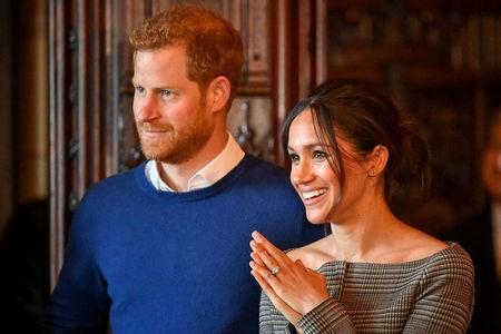 Britain's Prince Harry and his fiancee Meghan Markle (REUTERS/Ben Birchall/Pool/File Photo)