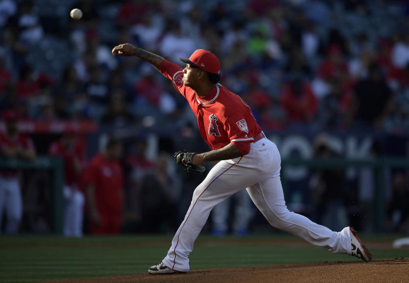 Los Angeles Angels starting pitcher Felix Pena throws during the first inning of the team's preseason baseball game against the Los Angeles Dodgers on Sunday, March 24, 2019, in Anaheim, Calif. (AP Photo/Mark J. Terrill)