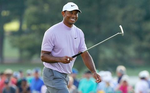 <span>Woods' trusty Scotty Cameron putter has won him another major championship</span> <span>Credit: Getty Images </span>