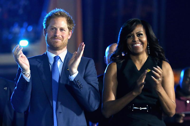 Prince Harry and Michelle Obama at the Invictus Games Orlando opening ceremony in 2016 [Photo: Getty]