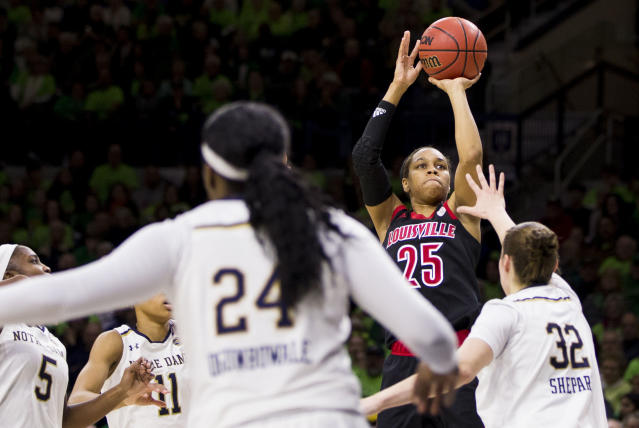 Louisville's Asia Durr (25) shoots a 3-pointer over Notre Dame's Jessica Shepard (32) during the first half of an NCAA college basketball game Thursday, Jan. 10, 2019, in South Bend, Ind. (AP Photo/Robert Franklin)