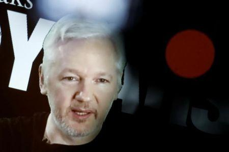 Julian Assange, Founder and Editor-in-Chief of WikiLeaks speaks via video link during a press conference on the occasion of the ten year anniversary celebration of WikiLeaks in Berlin