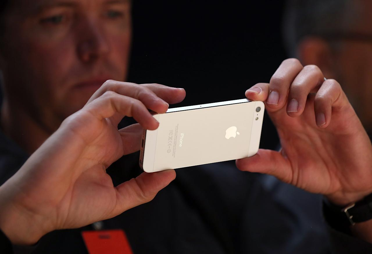 SAN FRANCISCO, CA - SEPTEMBER 12:  An attendee looks at the new iPhone 5 during an Apple special event at the Yerba Buena Center for the Arts on September 12, 2012 in San Francisco, California. Apple announced the iPhone 5, the latest version of the popular smart phone as well as new updated versions of the iPod Nano, Shuffle and Touch.  (Photo by Justin Sullivan/Getty Images)
