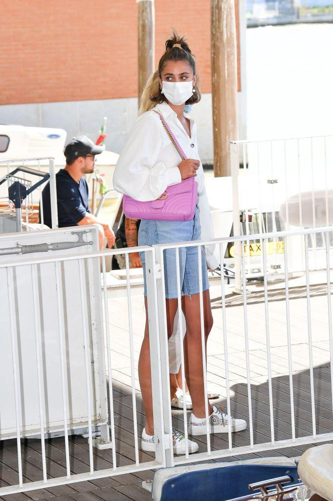 <p>The actress paired her casual shirt and denim shorts look with a mask while at the Venice Film Festival.</p>