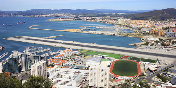 """<a rel=""""nofollow"""" href=""""http://au.totaltravel.yahoo.com/destinations/""""><b>Gibraltar International Airport</b></a> <br /><br/> This runway is the only one in the world with a major road running through the middle of it. Traffic on Winston Churchill Avenue has to be stopped every time a plane lands or takes off. Not only that, the short runway stretches out into the harbour.<br/><br/>"""