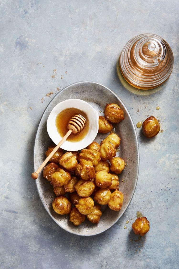 "<p>These balls of dough are glazed with honey for a perfectly sweet and bite-sized Hanukkah treat. Orange blossom water lends a light and bright citrusy flavor.</p><p><em><a href=""https://www.goodhousekeeping.com/food-recipes/a25309999/hanukkah-honey-balls-recipe/"" rel=""nofollow noopener"" target=""_blank"" data-ylk=""slk:Get the recipe for Hanukkah honey balls"" class=""link rapid-noclick-resp"">Get the recipe for Hanukkah honey balls</a></em></p>"