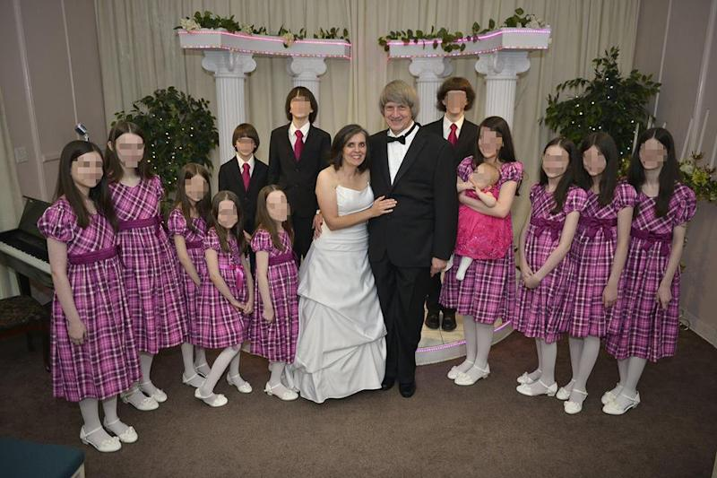 The Turpins posewith their 13 children, whom authorities said were extremely malnourished and physically abused.