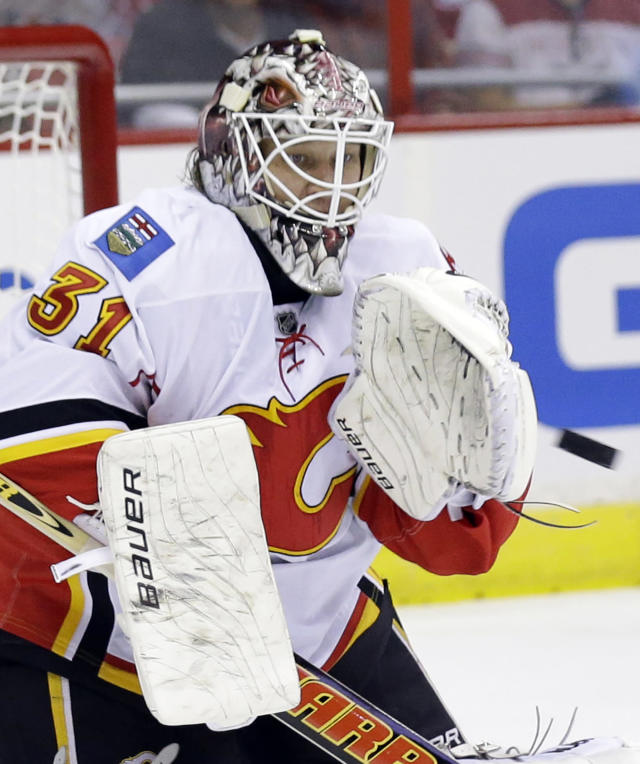 Calgary Flames goalie Karri Ramo (31), from Finland, catches a shot in the first period of an NHL hockey game against the Washington Capitals, Thursday, Oct. 3, 2013, in Washington. (AP Photo/Alex Brandon)