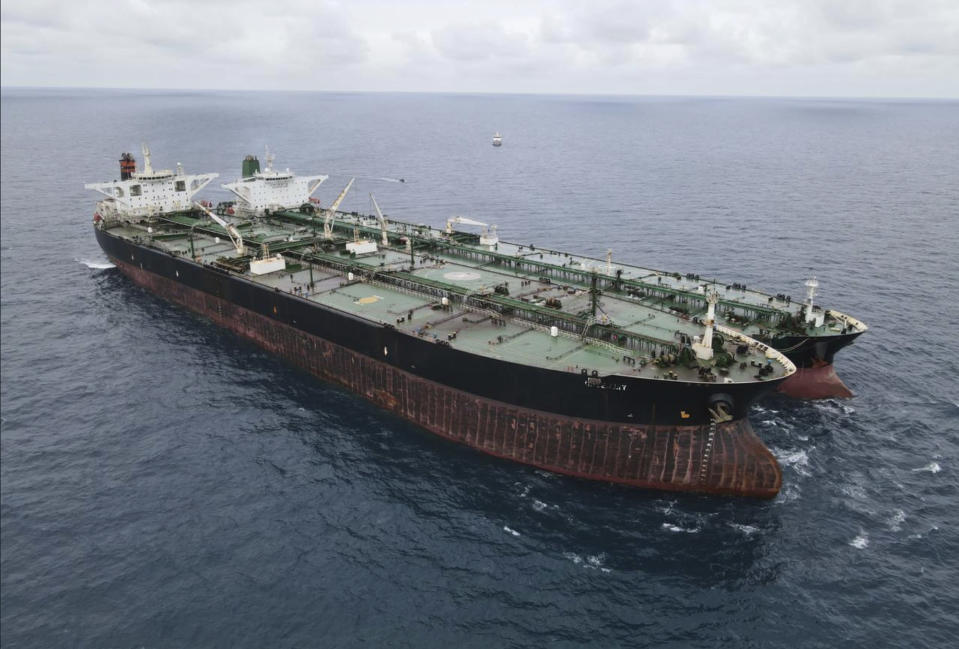 In this photo released by Indonesian Maritime Security Agency (BAKAMLA), Panamanian-flagged MT Frea, left, and Iranian-flagged MT Horse tankers are seen anchored together in Pontianak waters off Borneo island, Indonesia, Sunday, Jan. 24, 2021. Indonesian authorities said that they seized the two vessels suspected of carrying out the illegal transfer of oil in their country's waters. (Indonesian Maritime Security Agency via AP)