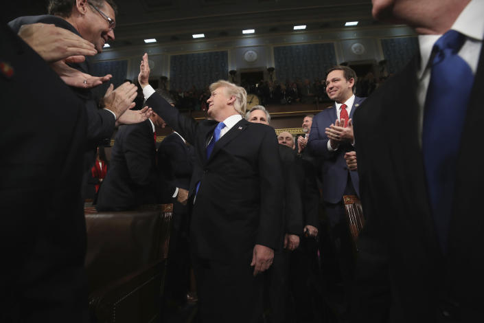 <p>Trump arrives to deliver his first State of the Union address to a joint session of Congress in the House chamber of the U.S. Capitol on Jan. 30 in Washington, D.C. (Photo: Win McNamee/AP) </p>