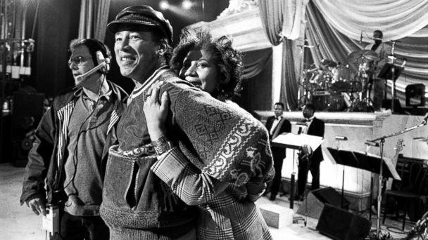 PHOTO: Aretha Franklin hugs Smokey Robinson at a rehearsal for the 'Aretha Franklin: Duets' concert to benefit the Gay Men's Health Crisis at the Nederlander Theater in April 1993 in New York. (Catherine McGann/Getty Images)