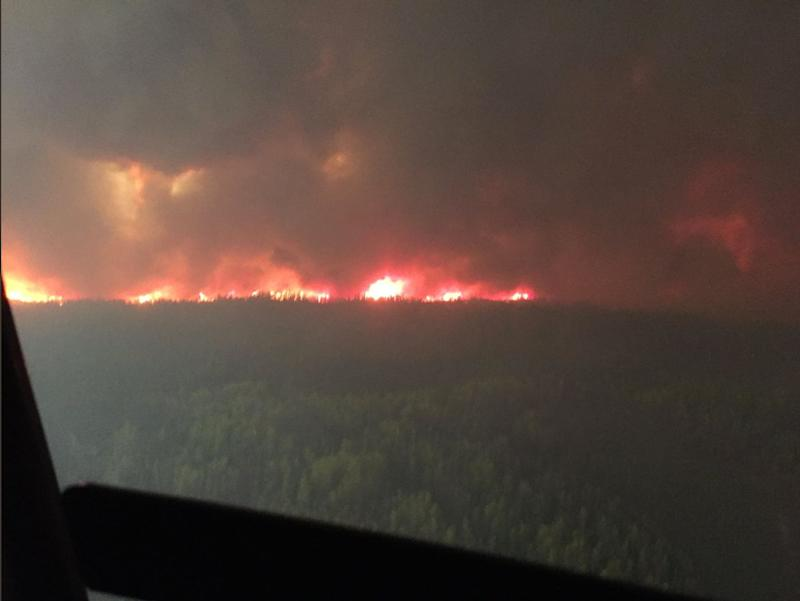 The Chuckegg Creek wildfire (HWF-042) burns out of control in the High Level Forest Area, to the southwest and west of the town of High Level, Alberta, Canada in this May 19, 2019 picture obtained from social media. (Alberta Wildfire/via Reuters)