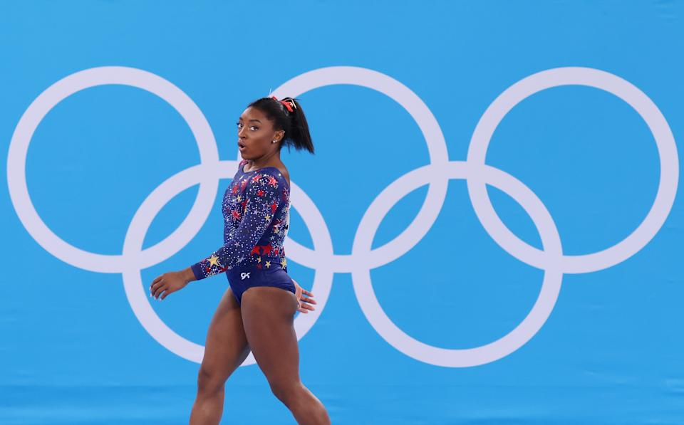 <p>TOKYO, JAPAN - JULY 25: Simone Biles of Team United States walks by the judges' table during Women's Qualification on day two of the Tokyo 2020 Olympic Games at Ariake Gymnastics Centre on July 25, 2021 in Tokyo, Japan. (Photo by Jamie Squire/Getty Images)</p>