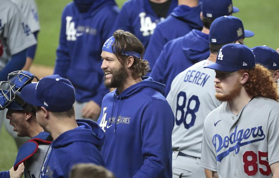 Game 5 starter Clayton Kershaw, center, smiles after the Dodgers move to within one win of the World Series championship.