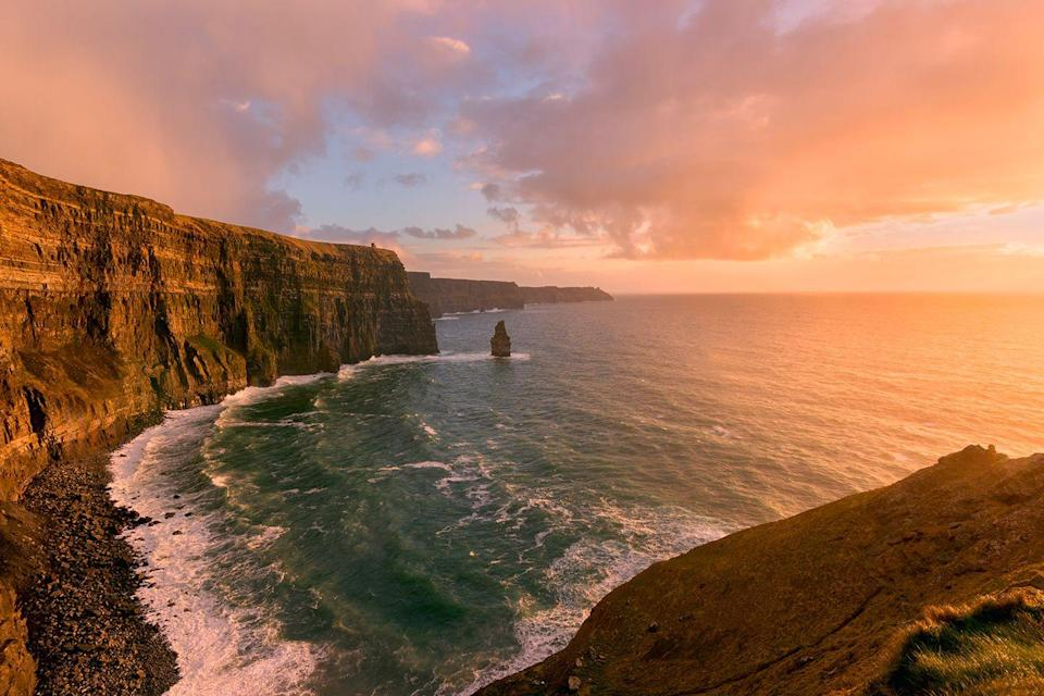 "<p><a href=""https://www.tripadvisor.com/Attraction_Review-g1184916-d214806-Reviews-Cliffs_of_Moher-Liscannor_County_Clare.html"" rel=""nofollow noopener"" target=""_blank"" data-ylk=""slk:This scenic spot"" class=""link rapid-noclick-resp"">This scenic spot</a> is one of Ireland's most photogenic places. The cliffs stretch for five miles along the Atlantic coast of Clare and ascend to over 700 feet. </p>"