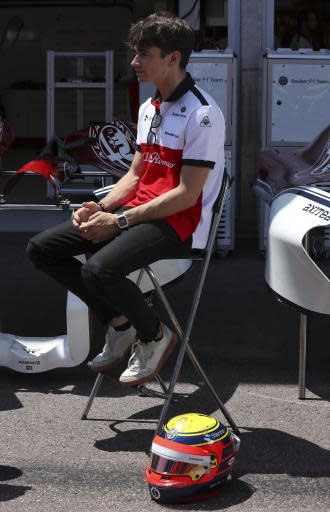 Sauber driver Charles Leclerc of Monaco seats news to his new helmet at the Monaco racetrack, in Monaco, Friday, May 25, 2018. The Formula one race will be held on Sunday. (AP Photo/Luca Bruno)