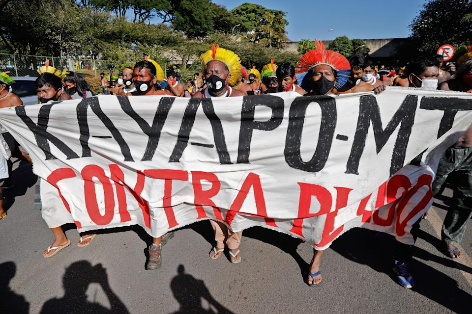 Indigenous people protest for the demarcation and preservation of their lands outside the National Congress in Brasilia on June 23, 2021. - Indigenous people are camping in the capital to oppose a bill that limits the recognition of reserve lands. (Photo by Sergio Lima / AFP) (Photo by SERGIO LIMA/AFP via Getty Images)