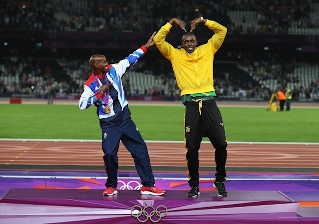 LONDON, ENGLAND - AUGUST 11: Gold medalist Mohamed Farah of Great Britain (L) and Usain Bolt of Jamaica pose on the podium on Day 15 of the London 2012 Olympic Games at Olympic Stadium on August 11, 2012 in London, England. (Photo by Clive Brunskill/Getty Images)
