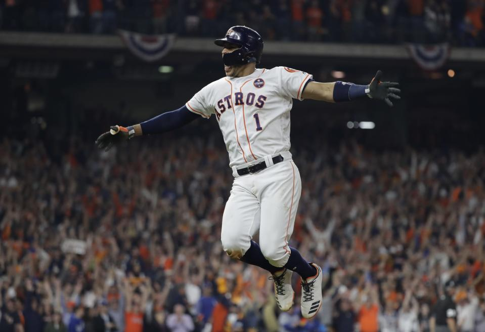 Carlos Correa knows how to celebrate awesome baseball things. (AP Photo)
