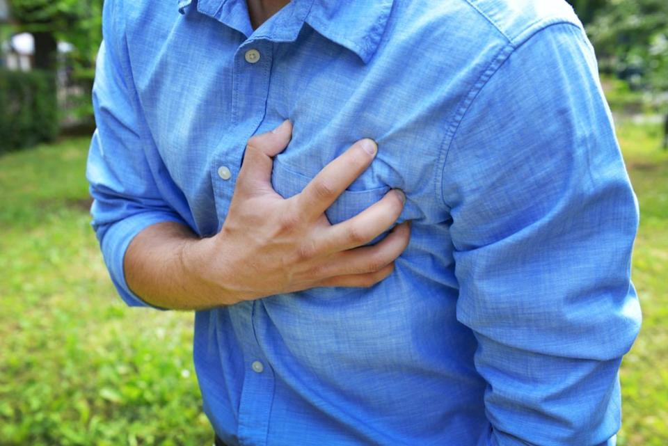 Man having chest pain - heart attack, outdoors