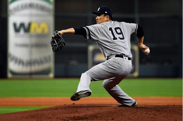HOUSTON, TX - OCTOBER 12: Masahiro Tanaka #19 of the New York Yankees pitches during Game 1 of the ALCS between the New York Yankees and the Houston Astros at Minute Maid Park on Saturday, October 12, 2019 in Houston, Texas. (Photo by Cooper Neill/MLB Photos via Getty Images)